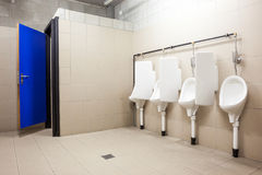 Urinal and toilet doors Royalty Free Stock Images