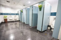 Urinal and toilet doors. Urinals and toilet doors in an old building for men only Stock Photography