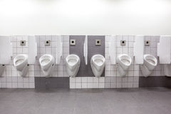 Urinal on the wall Stock Images