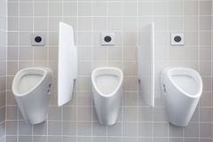 Urinal on the wall Stock Photography