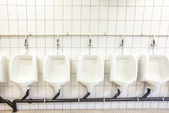 Urinal on the wall Royalty Free Stock Image