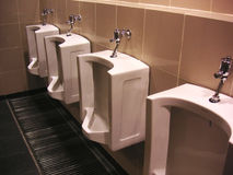 Urinals. Row of urinals in a public toilet Royalty Free Stock Image