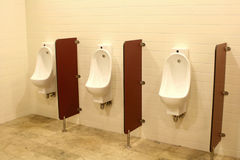 Urinals. Three men urinals in the public restroom Royalty Free Stock Photography