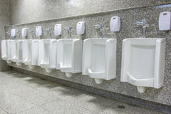 Urinals in bathroom Royalty Free Stock Images