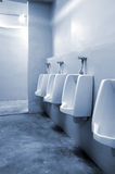 Urinals in bathroom at office Royalty Free Stock Photo