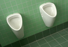 Urinals em um banheiro Fotografia de Stock Royalty Free