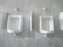 Urinals men public toilet. Stock Photo