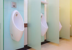 Urinals Men public toilet room, wc Stock Image