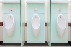 Urinals Men public in toilet room, wc Royalty Free Stock Photo
