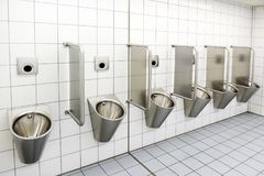 Urinals in men`s public modern toilet restroom sanitary or wc ar. Chitecture design concept Stock Image