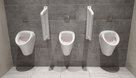 Urinals for men at toilet Stock Images