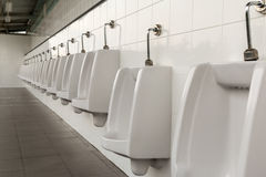 Urinals in the mens bathroom Royalty Free Stock Images