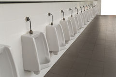 Urinals in the mens bathroom Royalty Free Stock Photo