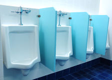 Urinals at office Stock Photo