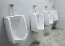 Urinals at office Royalty Free Stock Photography