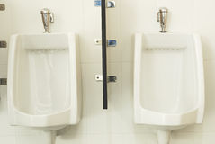 Urinals at office ,men toilet Stock Images