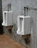 Urinals at office Stock Image