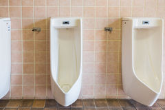 Urinals in an old building for men Royalty Free Stock Photos