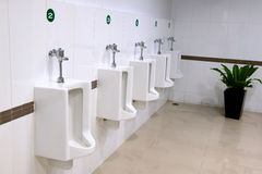 Urinals in a public men's room Royalty Free Stock Photography
