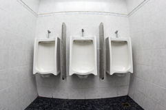 Urinals in public restroom Royalty Free Stock Photography