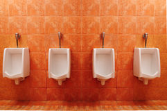 Urinals in public toilet Royalty Free Stock Images