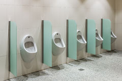 Urinals in a public toilet Stock Photography