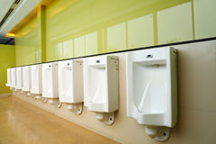 Urinals in public toilet Royalty Free Stock Photography