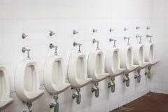 Urinals in public toilet Stock Photos