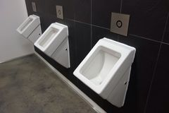 Urinals in a public toilet Royalty Free Stock Photos