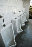 Urinals in public toilets Stock Photo
