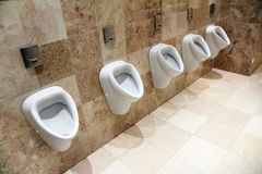 Urinals in restroom Royalty Free Stock Image