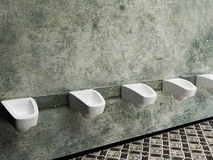Urinals in a row, public toilet. Rendering Stock Images