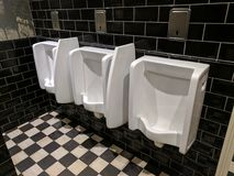 Urinals in a row Royalty Free Stock Photos