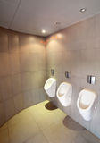 Urinals in toilet Stock Photo