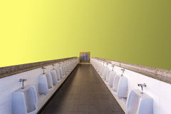 Urinals on yellow background. Stock Image