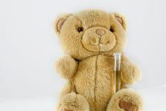 Urine sample. A teddy bear holding his urine sample royalty free stock photography