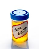 Urine Sample. Vial of urine with john smith name tag Royalty Free Stock Photos
