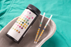 Urine test strips lying in a one use capsule royalty free stock image