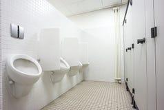 Urinoir en toiletdeuren Stock Fotografie