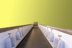 Urinoirs op gele achtergrond stock afbeelding