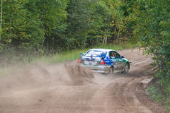 Uriy Ivanov drives a  Mitsubishi Lancer Royalty Free Stock Photography