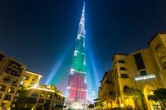 Urj Khalifa Tower floodlit in the white, green and red colours. DEC 03 -DUBAI, UAE:  Burj Khalifa Tower floodlit in the white, green and red colours of the flag Stock Photography