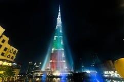 Urj Khalifa Tower floodlit in the white, green and red colours. DEC 03 -DUBAI, UAE:  Burj Khalifa Tower floodlit in the white, green and red colours of the flag Royalty Free Stock Images