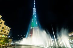 Urj Khalifa Tower floodlit in the white, green and red colours. DEC 03 -DUBAI, UAE: Burj Khalifa Tower floodlit in the white, green and red colours of the flag stock photography