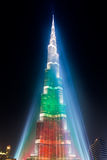 Urj Khalifa Tower floodlit in the white, green and red colours. DEC 03 -DUBAI, UAE:  Burj Khalifa Tower floodlit in the white, green and red colours of the flag Stock Images