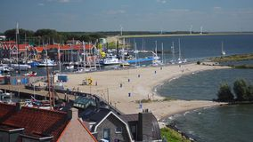 Urk beach and harbor entrance timelapse stock video
