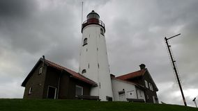 Urk Lighthouse. Clouds moving over the lighthouse at Urk in The Netherlands. Time lapse clip stock video footage