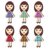 Urklippsbokflickor i olika klänningar Arkivfoto