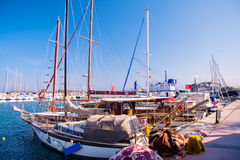 Urla, Tyrkey, waterfront views, stone slope, yachts Royalty Free Stock Photo