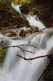 Urlatoarea waterfall with the milky water effect and stones. Urlatoarea waterfall in autumn season, Bucegi mountains, Romania Stock Image